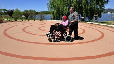 Robyn Franklin pushes her daughter Michelle Franklin around t newly opened Wallace Labyrinth at Clare Holland House.
