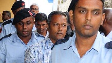 Charged ... Sandip Mooneea, centre, denies murdering Michaela McAreavey.