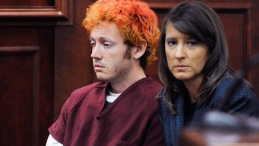 Bizarre ... Holmes sits with his lawyer, public defender Tamara Brady.