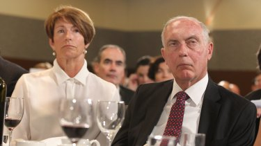 Margie Abbott and Deputy Prime Minister Warren Truss listen as Prime Minister Tony Abbott addresses the National Press Club in Canberra on Monday.