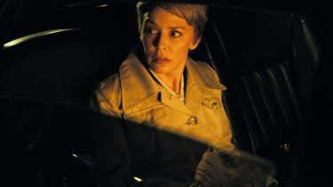 Kylie Minogue, in Jean Seberg hairdo, stars in French film <i>Holy Motors</i>.