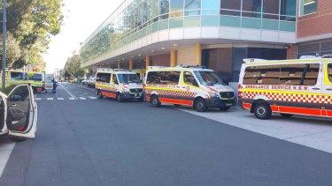 Severe delays: An ambulance queue 13 deep at Liverpool Hospital recently.