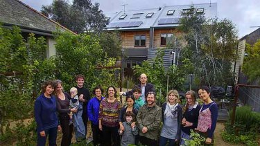 Urban Coup inner-city co-housing members (from left) Eleni Rivers, Bryony Edwards, Lucian Whitehead, Rowan Rivers Wagner, Sally MacAdams, Karen Hovenga, Rose Brown (front), Phuong Le, Tyson O'Shea, Alex Fearnside, James Brown, Tania Lewis, Caitlin O'Shea, and Ta Fearnside.