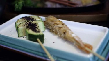 Kushiyaki ... zucchini skewer sprinkled with dried shiso leaf and a wholly edible prawn skewer.