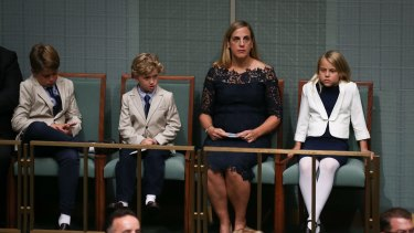 The Treasurer's family Xavier Hockey, Ignatius Hockey, Melissa Babbage and Adelaide Hockey listen to the budget reply speech in Parliament on Tuesday.