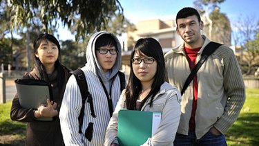 International students (from left) Seonah Kim, Lee Hee Jin, Lee Naree and Moustafa Ibrahim, outside Hawthorn-Melbourne College, are unhappy with the way they have been treated.