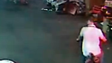 A man on a scooter notices the badly injured toddler before riding around her body and continuing without stopping.