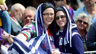 Fremantle supporters at the annual grand final parade through the streets of Melbourne.