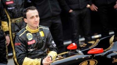 Polish driver Robert Kubica poses during the presentation of the new Lotus Renault GP R31.