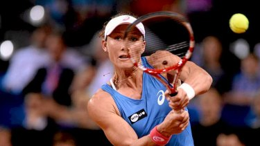 Tough day for seeds: Samantha Stosur of Australia plays a backhand in her match against Jelena Jankovic of Serbia.