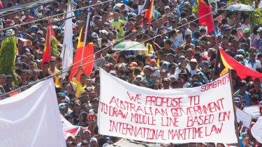 At least 10,000 people protested in Dili, East Timor's capital,  against Australia's stance on the oil and gas meridian line in the Timor Sea.