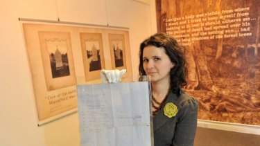 Elizabeth Marsden of the Victoria Police Museum holds a map drawn by the sole survivor of an ambush by the Kelly gang.