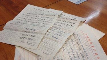 Documents Zhou Shiqin says show the money she is accused of embezzling was used legitimately.