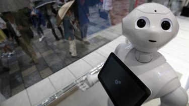 "New face: ""Pepper"" at work in a branch of SoftBank in Tokyo."