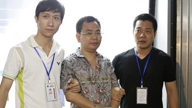 Lin Chunping is detained by police in east China's Zhejiang province earlier this month.