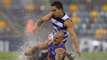 Splashdown: Lion Ash McGrath and Cat Mathew Stokes slip and slide in search of the Sherrin.