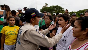 Tensions rise after customers waited in line for hours and their frustration turned into a street protest in Caracas.