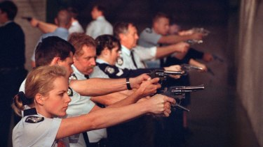 A policewoman pictured with colleagues at a pistol range in 1995.