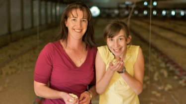 Birds in their hand... Cathy Muscat with her daughter, Stephanie, 11, at their Cawdor farm.