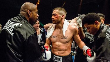 Rippling muscles and a mashed-up face: Jake Gyllenhaal (centre) in <i>Southpaw</i>, with Forest Whitaker (left).
