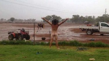 Cobar farmer James Rogers celebrating the arrival of rain.