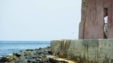 Time to remember: President Barack Obama looks out to sea from the Door of No Return during a tour of the House of Slaves museum, on Goree Island, in Dakar, on Thursday.