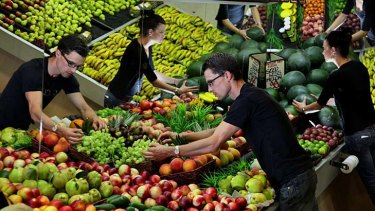 The owners of the Local Fruitologist at Green Point, Jeff Davies and his wife Karly, working in their shop.