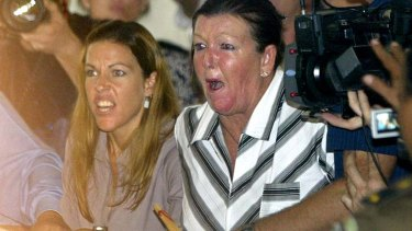 May 2005: Schapelle Corby's mother Rosleigh Rose, right, and sister Mercedes, left, reacts to judges' verdict during her trial.