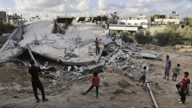 Palestinians look at the rubble of a building destroyed by an Israeli air strike in the northern Gaza Strip town of Beit Lahia on Tuesday.