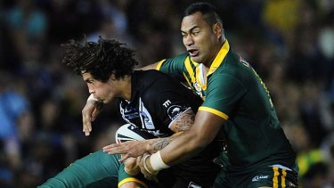 Heavy treatment … Tony Williams tackles New Zealand's Kevin Proctor.