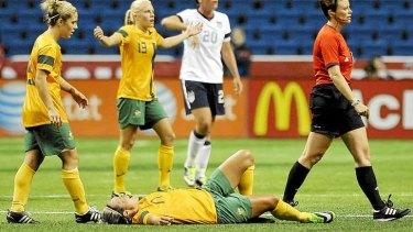 Injured: Kyah Simon awaits medical attention after suffering knee injury.