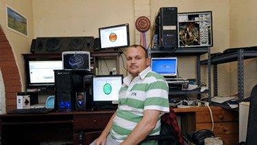 Emu Plains resident John Vandenberg and his bank of powerful PCs and laptops.