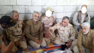 In this picture posted by the Iranian military, Major-General Qasim Suleimani, commander of Iran's paramilitary Quds Force, is seen second from left with Shiite leaders in Iraq.