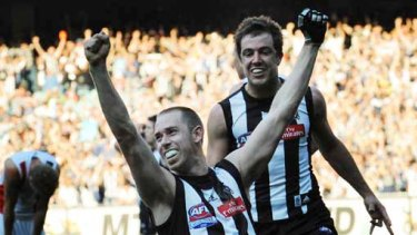 Collingwood captain Nick Maxwell and Steele Sidebottom celebrate as the final siren sounds.