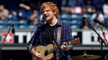 Top of his game: Ed Sheeran performs at the AFL Grand Final in Melbourne in September.