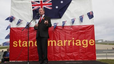 """Senator Barnaby Joyce addresses the National Marriage Day Rally with the message """"Husband and Wife Equals Life"""" on the front lawn of Parliament House"""