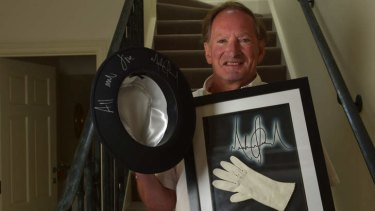 Collector of signed celebrity items Tim Fredman with a hat worn by Michael Jackson and one of the star's inner gloves.