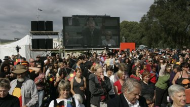 Crowds turn their backs on Brendon Nelson's response to Rudd's Apology, on the grounds at Federation Mall.