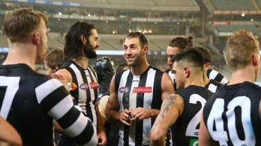 All smiles: Travis Cloke and teammates after the game.
