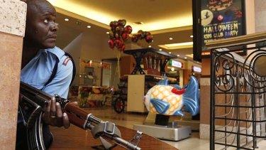 A police officer tries to secure an area inside the Westgate Shopping Centre in Nairobi where gunmen went on a shooting spree on September 21, 2013.