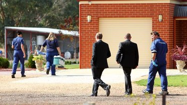 Police investigate the scene of a double homicide at the property just outside of Wangaratta.
