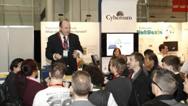 Magician David Welzman performs at a trade show.