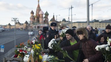 People lay flowers at the place where Boris Nemtsov was gunned down.