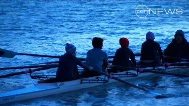 Another group of teens row on the Brisbane River near the scene of this morning's accident.