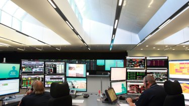 Rio Tinto staff monitor activity in the operations centre in Perth, where trucks and rigs are controlled remotely in the Pilbara mines.