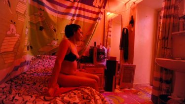 A Tunisian prostitute in a brothel in the district of Abdallah Guech, Tunis.