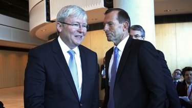 Not looking: Kevin Rudd and Tony Abbott avoid eye contact at the opening last month of the ASIO headquarters in Canberra.