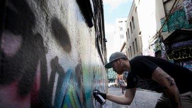 Graffiti artist The Kromster in Hosier Lane
