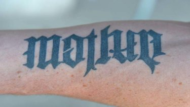 """Tatt's clever: a tattoo on Carlisle's left arm can be read as """"mother"""" one way."""