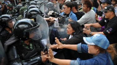 Protesters confront soldiers blocking the route of an anti-coup march in Bangkok.